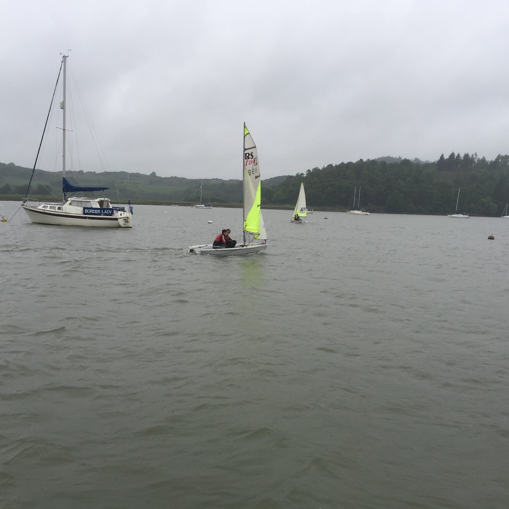 The RS Feva of James Howie and Charles Birdsall chasing their sisters Philippa and Louisa but they're already round the turning mark and well ahead